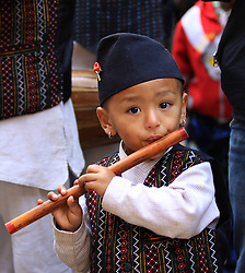60823368  <br /> A boy plays flute during the Indrayani Festival at Kirtipur, outskirts of Kathmandu, Nepal, Dec. 12, 2013. The festival is celebrated every year with the goddess Indrayani and lord Ganesh kept in chariots and roamed around the streets of Kirtipur with traditional instruments, Thursday, 12th December 2013. Picture by  imago / i-Images<br /> UK ONLY
