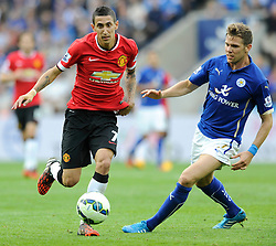 Manchester United's Angel Di Maria is closed down by Leicester City's Dean Hammond - Photo mandatory by-line: Dougie Allward/JMP - Mobile: 07966 386802 - 21/09/2014 - SPORT - FOOTBALL - Leicester - King Power Stadium - Leicester City v Manchester United - Barclays Premier League