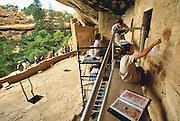 350405-1018 ~ Copyright: George H. H. Huey ~ Graduate student archaeologists from the University of Pennsylvania stabilizing original Anasazi plaster. Spruce Tree House, Mesa Verde National Park, Colorado.