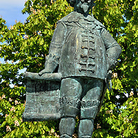 Christian IV Bronze Statue in Kristiansand, Norway <br /> This bronze statue celebrates when Christian IV established a new town along the sand of the Otra river in 1641. He named it after himself: Christianssand. This image of the former King of Denmark and Norway holding a scroll stands proudly in a medium along Festningsgata, the main boulevard that runs through the center of Kristiansand.  The sculpture was created in 1982 by Vinje Gunnerud.