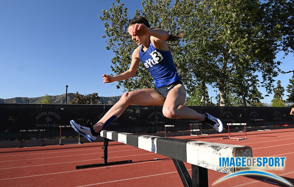 Apr 18, 2019; Azusa, CA, USA; Erica Birk of BYU hurdles a barrier in the women's steeplechase at the Bryan Clay Invitational at Azusa Pacific University. Birk won in a stadium record of 9:55.57.