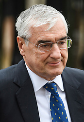 © Licensed to London News Pictures. 31/03/2018. Cambridge, UK. Conservative Party patron SIR MICHAEL HINTZE, arrives for The funeral of Stephen Hawking at Church of St Mary the Great in Cambridge, Cambridgeshire. Professor Hawking, who was famous for ground-breaking work on singularities and black hole mechanics, suffered from motor neurone disease from the age of 21. He died at his Cambridge home in the morning of 14 March 2018, at the age of 76. Photo credit: Ben Cawthra/LNP