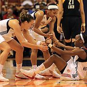 Allison Hightower, Connecticut Sun is helped up by team mates Kelsey Griffin, (left) and  Sydney Carter after being fouled while landing a three point basket during the Connecticut Sun V Tulsa Shock WNBA regular game at Mohegan Sun Arena, Uncasville, Connecticut, USA. 2nd July 2013. Photo Tim Clayton
