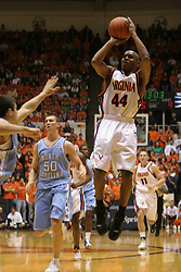 Sean Singletary (44) shoots a three pointer over a UNC defender.  Singeltary's 18 points helped lead the Wahoos to a 72-68 victory over the defending national champions.