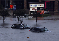 (170827) -- HOUSTON, Aug. 27, 2017 (Xinhua) -- Vehicles are submerged in flood in great Houston area, Texas, the United States, Aug. 27, 2017 as the Hurricane Harvey made its strong landfall over the Texas Gulf Coast Friday night. Widespread and worsening flood conditions prompted the closure of nearly every major road in Houston as the outer bands of Harvey swept through the Houston area over the weekend. Latest news reports said the storm death toll has climbed to at least 5. (Xinhua/Song Qiong) (Photo by Xinhua/Sipa USA)