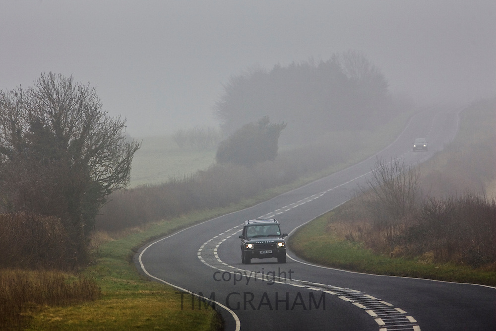 Cars drive along foggy road, Oxfordshire,  United Kingdom