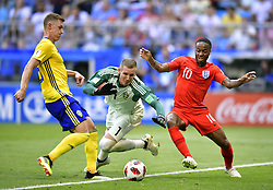 July 7, 2018 - Samara, Russia - RAHEEM STERLING (R) of England vies with goalkeeper ROBIN OLSEN (C) and EMIL KRAFTH of Sweden during the 2018 FIFA World Cup quarter-final match between Sweden and England in Samara. (Credit Image: © Chen Yichen/Xinhua via ZUMA Wire)