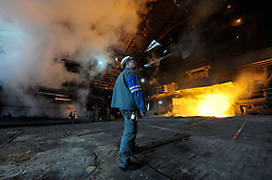 An Arcelor-Mittal employee, monitors blast furnace B, at the Ougree facility near Liege, Belgium, Monday, Feb. 9, 2009. (Photo © Jock Fistick)