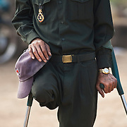 Cambodian Government soldier Mar Viehet, 48, walks near Veal Thom village in Kampon Speu, Cambodia, Saturday, Feb, 14, 2009. Viehet lost a leg to a landmine while fighting against the Khmer Rouge in 1980. Cambodia continues to wrestle with its past as UN backed tribunals continue for the former leaders of the Khmer Rouge who are accused of genocide.  An estimated 1.5 million Cambodians perished during the reign of the Khmer Rouge.