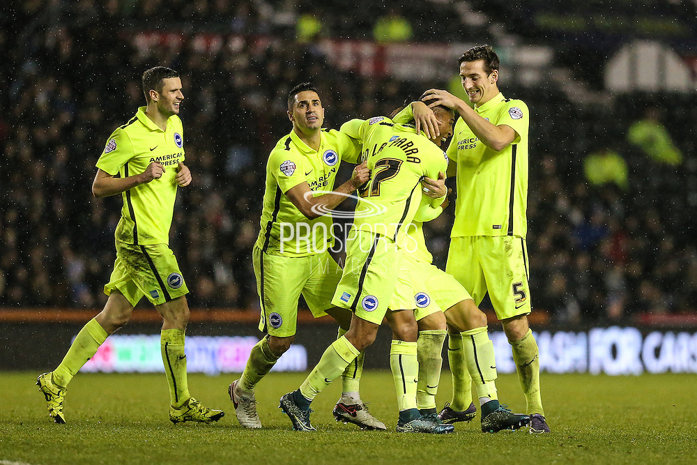 Brighton players celebrate with Rajiv van La Parra after he scored their second goal during the Sky Bet Championship match between Derby County and Brighton and Hove Albion at the iPro Stadium, Derby, England on 12 December 2015. Photo by Shane Healey.