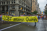 "Marchers carry a banner reading ""LGBT against Quinn."" Christine Quinn, a lesbian City Councillor who is runing for mayor in 2013, has a number of detractors in the city."