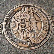 A plaque embedded into the sidewalk marking the Barbary Coast Trail in San Francisco's Fisherman's Wharf.