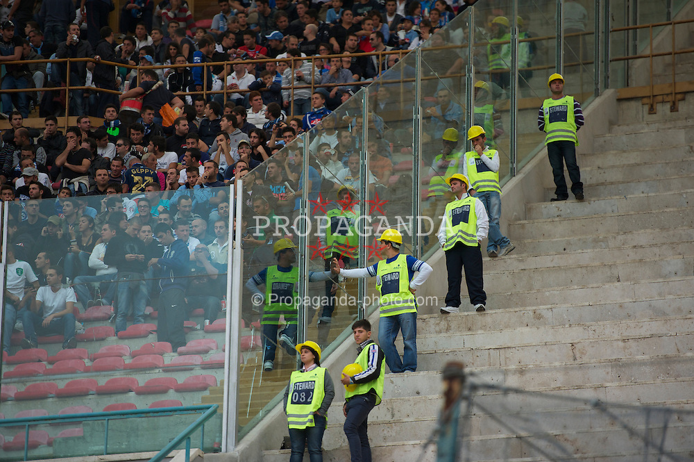 NAPELS, ITALY - Thursday, October 21, 2010: SSC Napoli stewards wearing protective hard hats during the UEFA Europa League Group K match against Liverpool at the Stadio San Paolo. (Pic by: David Rawcliffe/Propaganda)