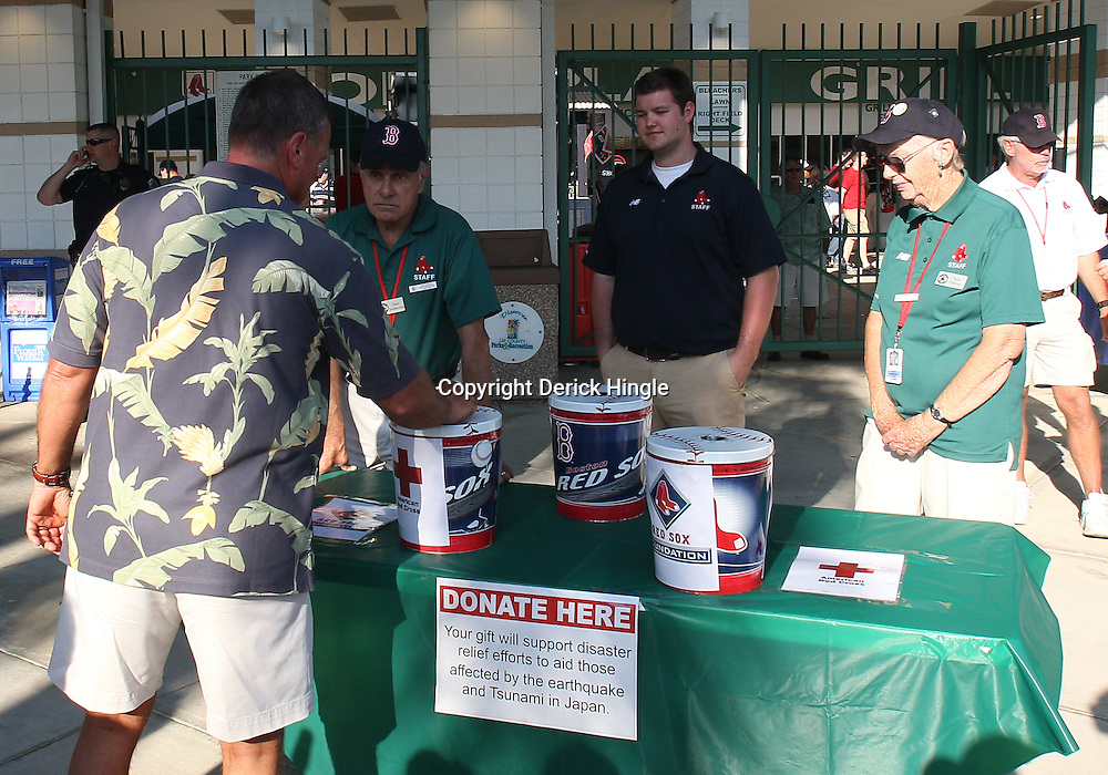 March 14, 2011; Fort Myers, FL, USA; The Boston Red Sox collect donation for the tsunami and earthquake victims of Japan prior to a spring training exhibition game against the New York Yankees at City of Palms Park.   Mandatory Credit: Derick E. Hingle