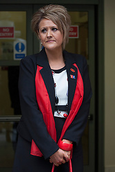 © licensed to London News Pictures. London, UK 25/04/2013. Louise Brooks, who lost her brother Andrew Mark Brooks, joins other families of the 96 football fans who lost their lives in the Hillsborough disaster at the Family Division of the High Court in London on Thursday, 25 April 2013. A hearing to decide the date and location of a new inquest into the 96 people who died in the Hillsborough disaster has begun in London. Photo credit: Tolga Akmen/LNP
