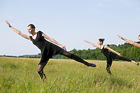 Young women stretch in a field