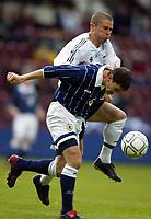 Photo Aidan Ellis.<br />Scotland v New Zealand (intl friendly at Tynecastle)<br />27/05/2003.<br />Scotland's Jackie Mcnamara and Kiwi Noah Hickey