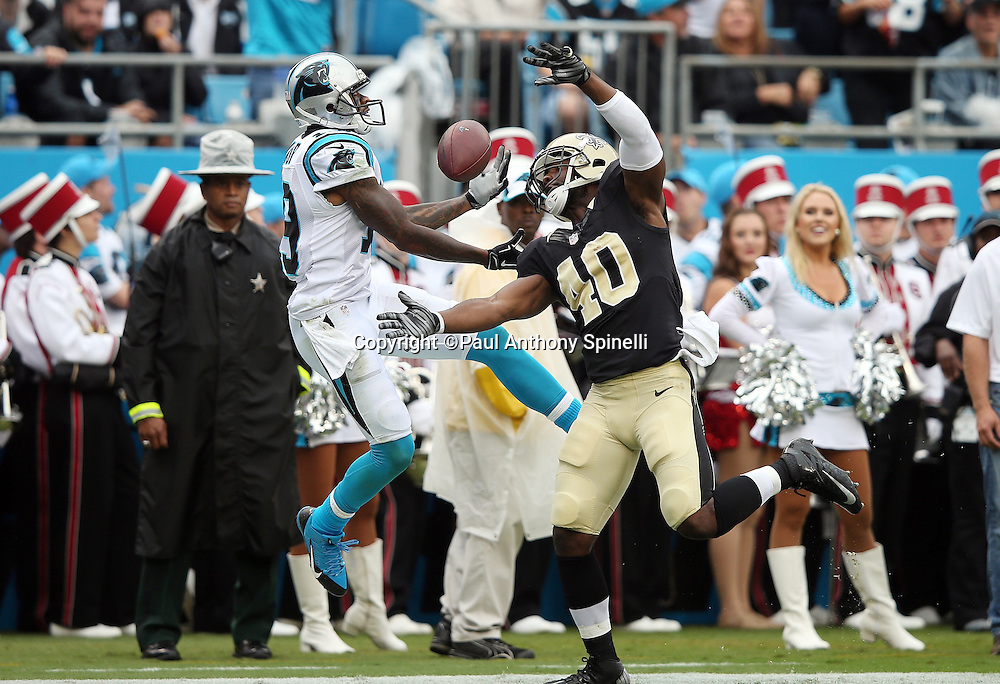 New Orleans Saints cornerback Delvin Breaux (40) breaks up an end zone pass intended for Carolina Panthers wide receiver Ted Ginn, Jr. (19) in the second quarter during the 2015 NFL week 3 regular season football game against the Carolina Panthers on Sunday, Sept. 27, 2015 in Charlotte, N.C. The Panthers won the game 27-22. (©Paul Anthony Spinelli)