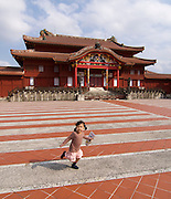Shurijo? Castle. Little girl running across Una forecourt in front of the Seiden (main hall).