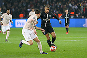 Kylian Mbappe of Paris Saint-Germain takes on Manchester United Defender Victor Lindelof during the Champions League Round of 16 2nd leg match between Paris Saint-Germain and Manchester United at Parc des Princes, Paris, France on 6 March 2019.