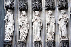 Carved stone statues at entrance to Cologne Cathedral