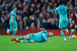 LIVERPOOL, ENGLAND - Saturday, December 29, 2018: Arsenal's Aaron Ramsey lies injured during the FA Premier League match between Liverpool FC and Arsenal FC at Anfield. (Pic by David Rawcliffe/Propaganda)