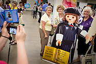 Participants pose with the Martin Luther Playmobil cutout in the Concordia Publishing House area of the exhibit hall during the 36th Biennial Convention of the Lutheran Women's Missionary League on Friday, June 26, 2015, at the Iowa Events Center in Des Moines, Iowa. LCMS Communications/Erik M. Lunsford