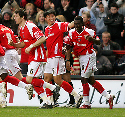 London, England - Saturday, January 12th, 2008:  Charlton Athletic's Zheng Zhi celebrates scoring the fourth goal with Lloyd Sam against Blackpool during the League Championship match at The Valley. (Pic by Chris Ratcliffe/Propaganda)