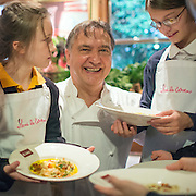 © Licensed to London News Pictures. 03/11/2014. Oxford, UK. RAYMOND BLANC with local school children after finishing their ravioli dishes.  To celebrate National School Meals Week (3-7 November), the Deputy Prime Minister, Nick Clegg, joins school children at Brasserie Blanc in Oxford to get some top cooking tips from Raymond Blanc. The visit is part of a larger national effort to raise awareness of and enhance children's relationship with food. The Deputy Prime Minister has called on celebrity chefs to lead the way by joining forces with school cooks to promote the great school lunch. School cooks up and down the country will be taking their skills out of the school kitchen to showcase to parents and pupils the variety and quality of food now being served in schools. National School Meals Week comes just months after the launch of free school meals for 2.8 million primary school children and the introduction of cooking in the curriculum.. Photo credit : Stephen Simpson/LNP