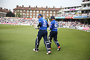England Alex Hales and England Jason Roy walk to the crease to open the batting during the Royal London One Day International match between England and New Zealand at the Oval, London, United Kingdom on 12 June 2015. Photo by Phil Duncan.