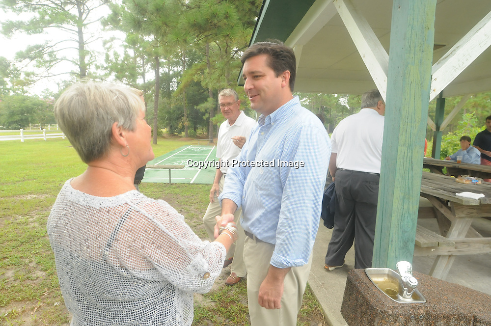 David Rouzer, Republican candidate for Congress in North Carolina's 7th Congressional District talks to constituents Saturday August 9, 2014 at Lockwood Folly Community Building in Supply, N.C. (Jason A. Frizzelle)