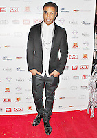 LONDON - November 27: Lucien Laviscount at the OK! Magazine - Christmas Party (Photo by Brett D. Cove)
