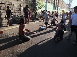 April 14, 2017 - Navotas City, Philippines - Flagellants crawling on the street. as the sun continue to rise. (Credit Image: © Josefiel Rivera/Pacific Press via ZUMA Wire)