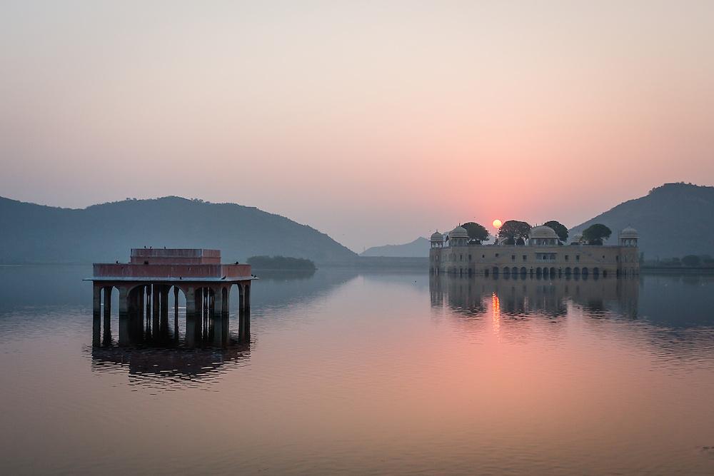 Near Jal Mahal (Water Palace), on the outskirts of Jaipur, the pinkish hues of sunrise complement Jaipur's nickname of 'The PInk city'