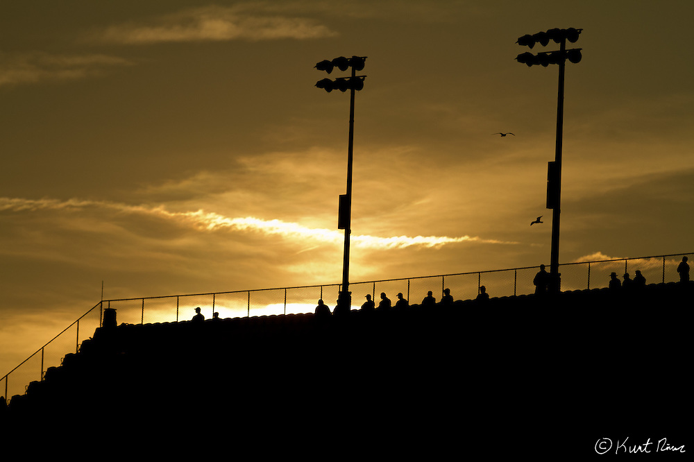 Spectators in the stands as the sun sets during the Rolex 24 Hour Race at Daytona International Speedway in Daytona Beach, FL on January 28, 2012 (Kurt Rivers)