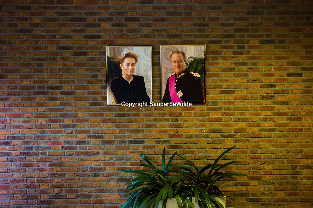 King Albert and Queen Paola of Belgium hang on all walls of government-buildings.