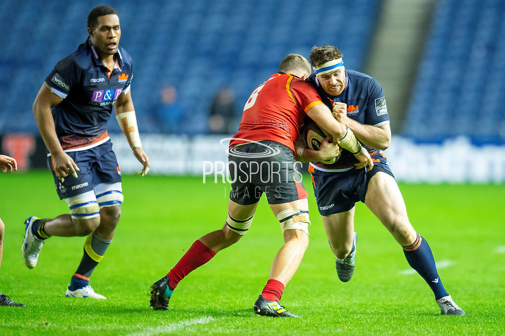 Simon Berghan (#3) of Edinburgh Rugby is tackled by Ruaan Lerm (#8) of Isuzu Southern Kings during the Guinness Pro 14 2018_19 rugby match between Edinburgh Rugby and Isuzu Southern Kings at the BT Murrayfield Stadium, Edinburgh, Scotland on 5 January 2019.