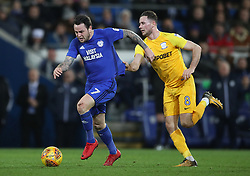 Cardiff City's Lee Tomlin (left) gets held back by Preston North End's Alan Browne during the Sky Bet Championship match at The Den, London.