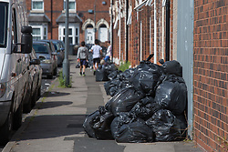 &copy; Licensed to London News Pictures. 25/07/2017. Birmingham, UK. The strike by Birmingham bin men continues as piles of rubbish in certain areas goes uncollected.<br /> Pictured, children playing in Tarry Road, Alum Rock.  Photo credit: Dave Warren/LNP