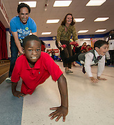 Principal Aaron Dominguez, left, and students participate in a pep rally to energize for STAAR testing at Garcia Elementary School, March 27, 2014.