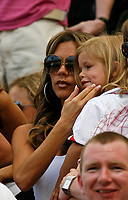 Photo: Glyn Thomas.<br />England v Paraguay. Group B, FIFA World Cup 2006. 10/06/2006.<br /> Victoria Beckham, or Posh Spice, wife of England captain David Beckham, watches the match with one of their children.