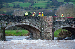 © Licensed to London News Pictures. 09/02/2014. Llangynidr,Wales, UK. Rescue services at the bridge over the river Usk at Crickhowell. A canoeist went missing today around midday on the River Usk. Photo credit : Graham M. Lawrence/LNP