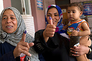 Egyptians  women  proudly display their fingers that have been marked with ink after they casted their vote at a polling station in the El Mokattam neighborhood of  Cairo , Egypt May 23, 2012. Egyptians head to the polling stations throughout Egypt  Wednesday for an historic opportunity in which they will for the first time to pick their president in a wide open election that pits Islamists against men who served under deposed leader Hosni Mubarak.(Photo by Heidi Levine/Sipa Press).