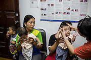 Lao baby twins cataract surgery story. Seven months old twin baby boys Samlan and Sintan, travel  with their mother 28 year old Chun Souk from their remote village Art Namn in the countries north on the boarders of China and Thailand to the Lao regional hospital at Hauy Xai in Bokeo Province. The Fred Hollows Lao office team to brought the blind twin baby boys three hours by boat down the Nam Tah River from their tiny remote village of Art Namn to the regional hospital. Senior eye surgeon Dr Phetsamone and young ophthlamologist Dr Sonjay operated on the the twins removing the patches the next day after surgery.
