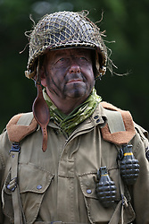 © Licensed to London News Pictures. 27/04/2018. Denmead, UK. A participant, dressed as an American from the 101st Airbourne Division, takes part in the Overlord Military Spectacular, a gathering of military re-enactors. The event, 1st held in 1977, is organised by The Solent Overlord Military Collectors Club and features some 200 military vehicles and 500 re-enactors dressed in authentic uniforms and equipment from the era.   Photo credit: Julian Herbert/LNP