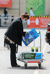 © Licensed to London News Pictures. 27/04/2020. London, UK. A shopper wearing a face mask with compost on a shopping trolley outside Homebase in Haringey, north London which opened today. The lockdown continues to slow the spread of COVID-19 and reduce pressure on the NHS. Photo credit: Dinendra Haria/LNP