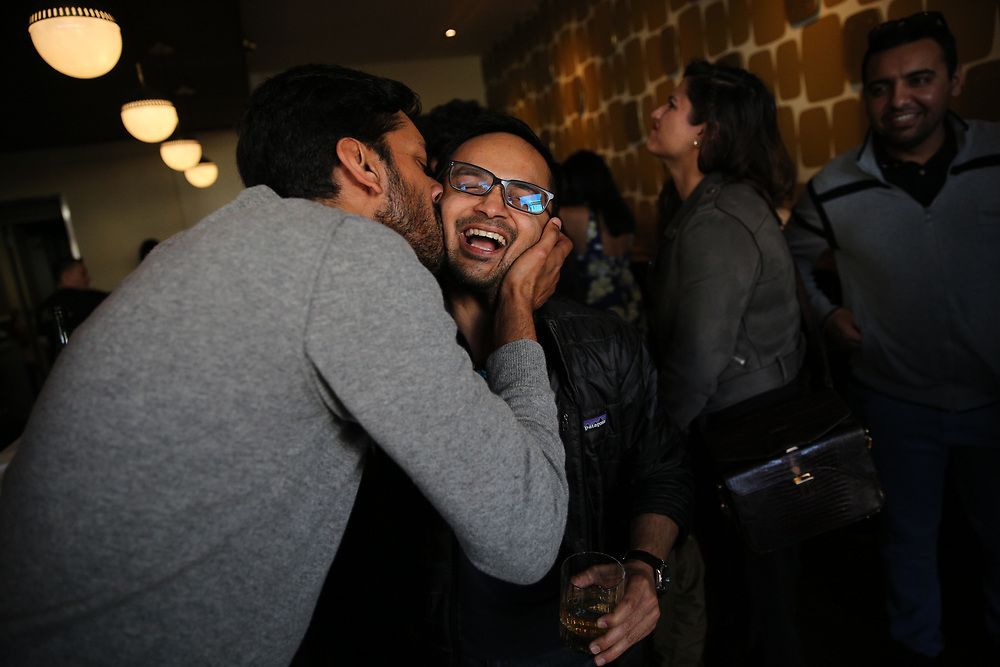 From left: Arjun Venkatesh kisses his friend Tapan Maniar at at The Beehive, Saturday, May 5, 2018, in San Francisco, Calif. The Beehive is located at 842 Valencia Street.