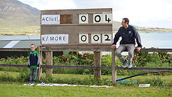 Oisin Murphy and his dad Cormac keeping the scoreboard uptodate during the junior champonship match between Achill and Knockmore in Polranny Achill on saturday evening last.<br /> Pic Conor McKeown