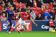 Charlton Athletic midfielder Jordan Cousins and Bristol City defender Nathan Baker during the Sky Bet Championship match between Bristol City and Charlton Athletic at Ashton Gate, Bristol, England on 26 December 2015. Photo by Jemma Phillips.