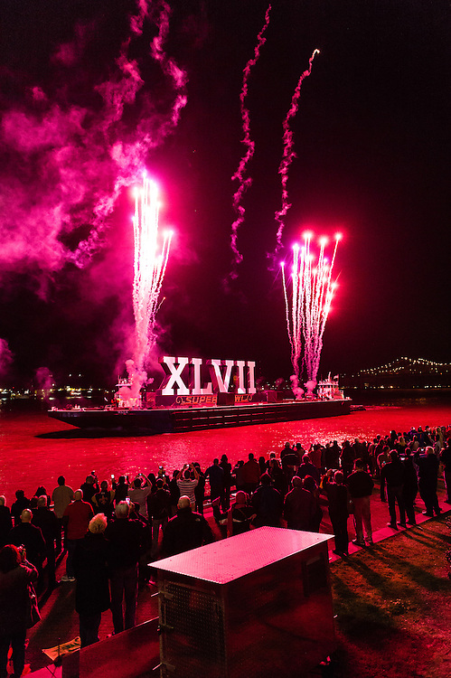 The opening fireworks display makes its way down the Mississippi River at Super Bowl XLVII in New Orleans, Louisiana.